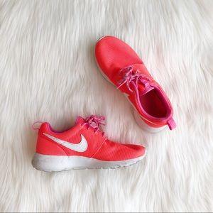 Bright orange Nike Roshe run shoes
